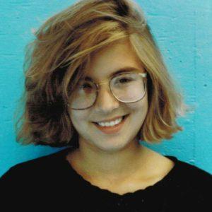 Photo of Cherri with blue background